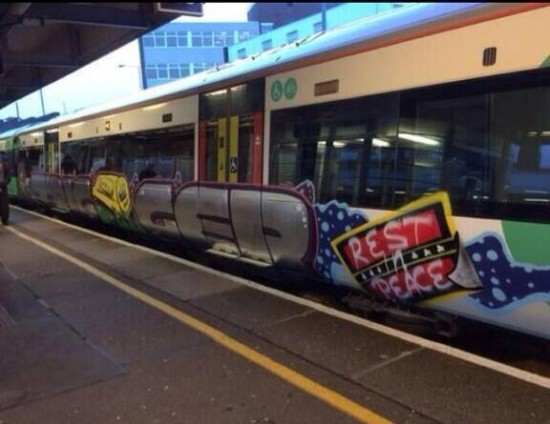 this is graffitied on side of train! Amazing